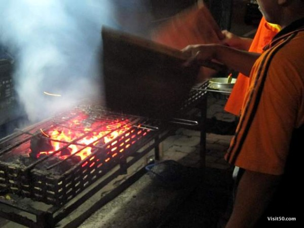 Indonesian BBQ fish - they use this waving method to grill