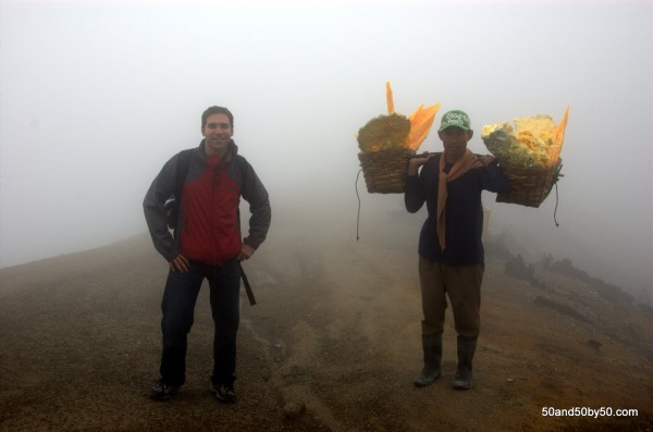 Man carries sulfur up from the sulfur mine, around the mountain, and then down