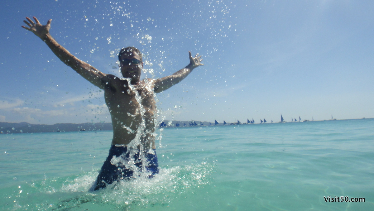 me! Jumping out of the crystal clear water in beautiful Boracay, Philippines