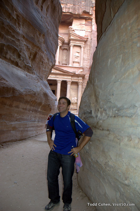 "at the Siq, the narrow passageway to Al Khazneh (""The Treasury"") at the ruins in Jordan"
