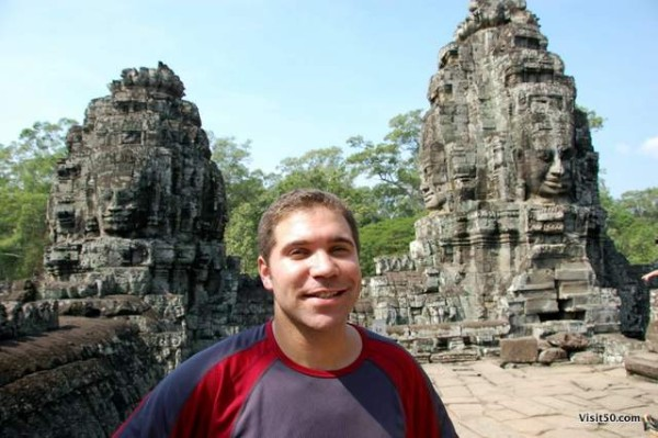 my face between the faces of the Bayon temples, in the Bayon ruins in Angkor Wat Angkor Thom area in Cambodia